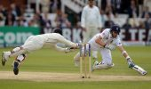 England's Joe Root (right) dives to avoid being run-out by New Zealand's Bradley-John Watling (left) during the first test at Lord's Cricket Ground, London. PRESS ASSOCIATION Photo. Picture date: Saturday May 18, 2013. See PA story CRICKET England. Photo credit should read: Anthony Devlin/PA Wire. RESTRICTIONS: Use subject to restrictions. Editorial use only. No commercial use. Call 44 (0)1158 447447 for further information.